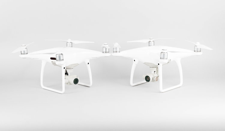 Both drones are designed extremely alike thought the Pro does feature a larger camera