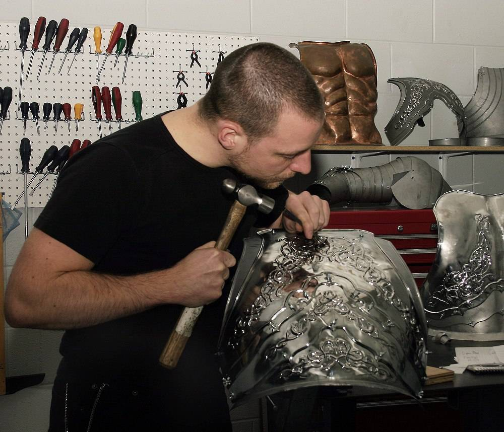 Yves Lemay working  on an upper body armor