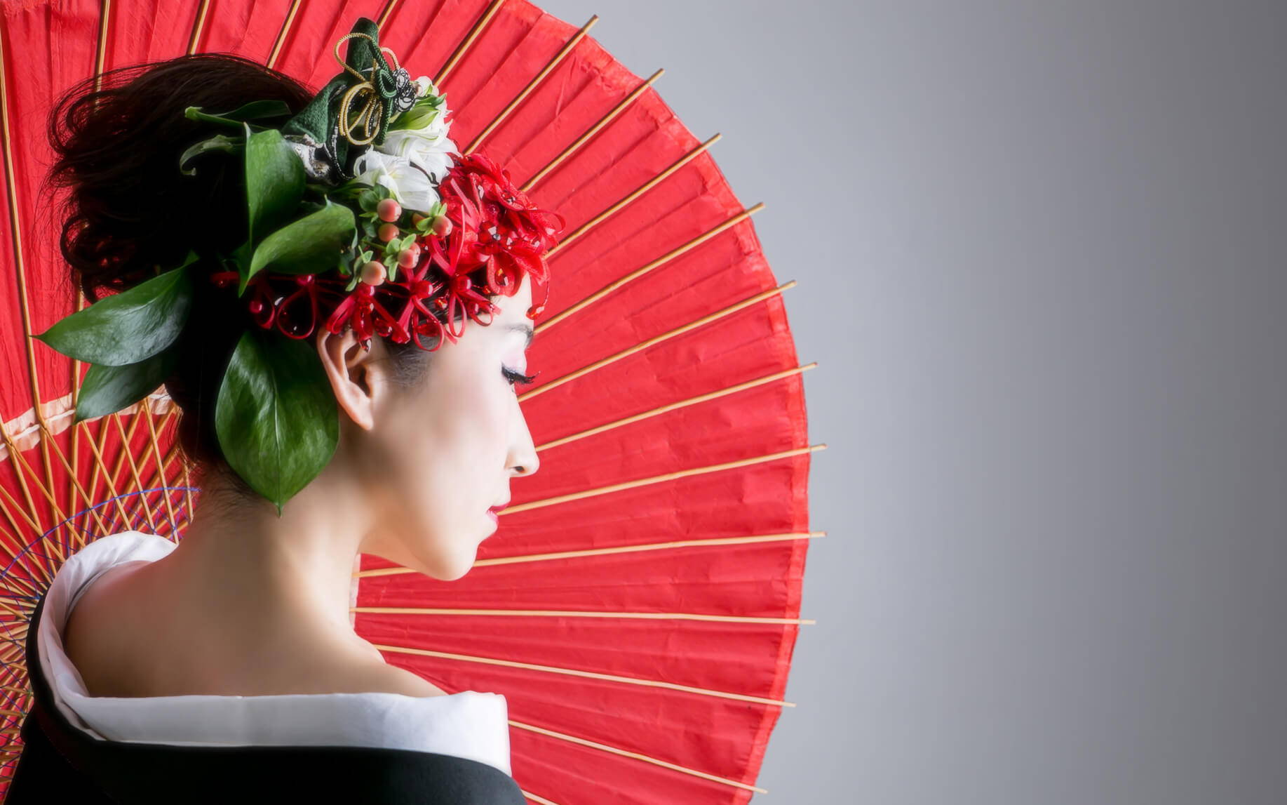 Geisha with a red oil-paper umbrella