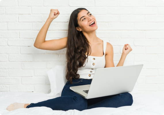 sleep zone bedding   website store products pages energetic life great sleep woman holding laptop laughing on bed
