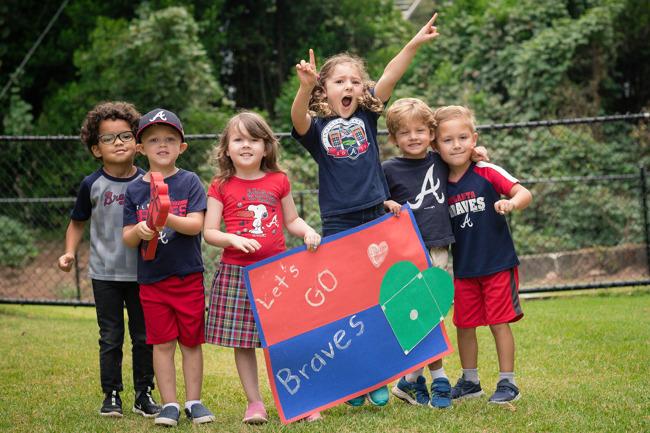 Children cheering on The Braves