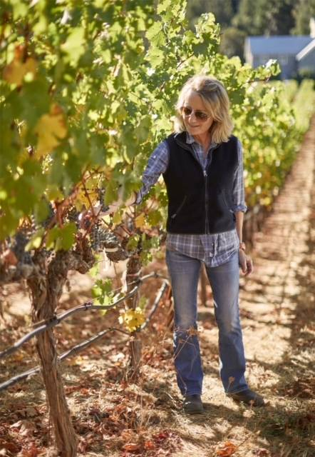 ToyMaker Cellars winemaker Martha McClellan working in the vineyard with grapes, also of Sloan Estate, Checkerboard Vineyards, Levy & McClellan, and formerly of Harlan Estate