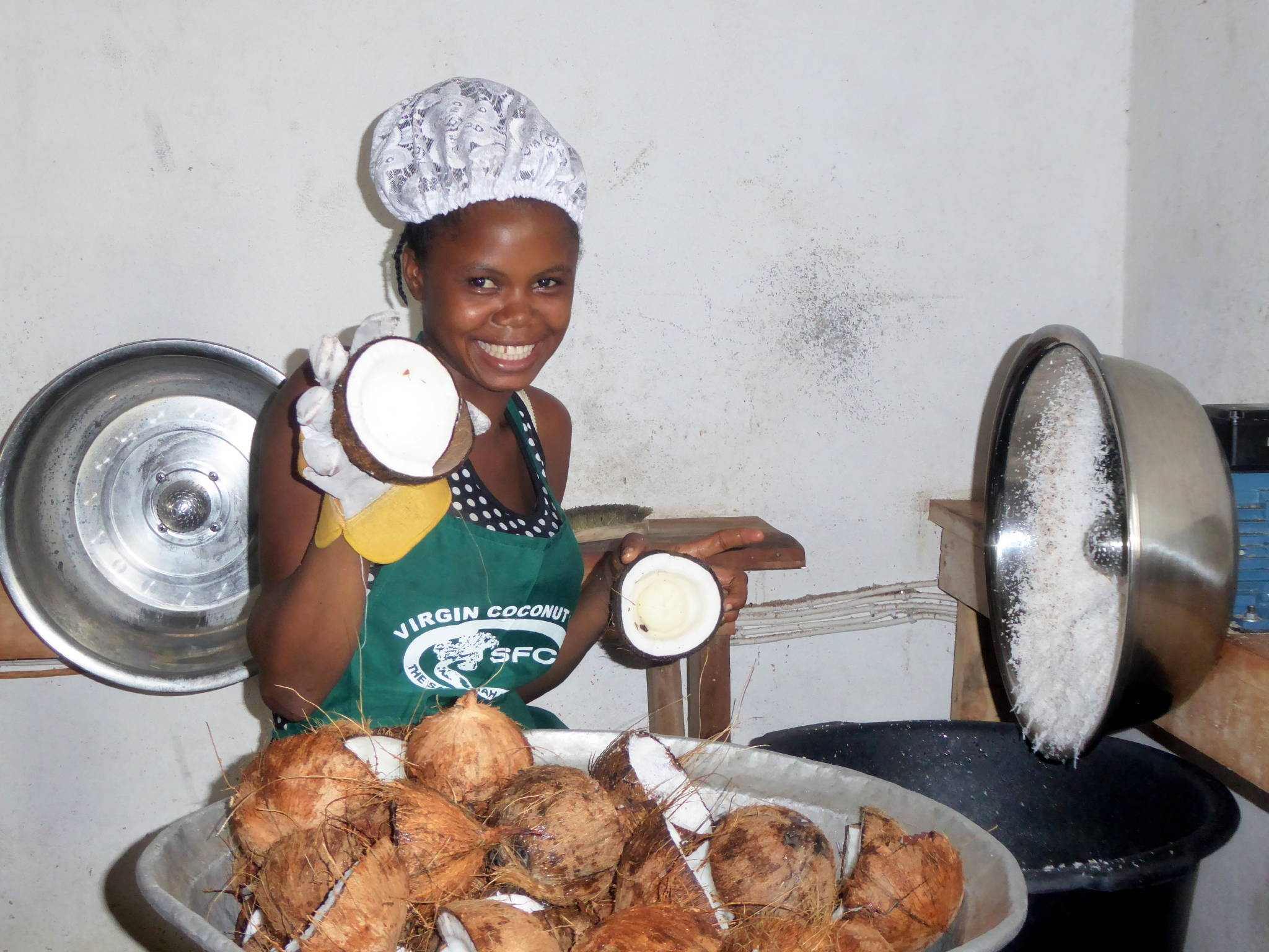 Woman manufacturing coconut oil in Ghana