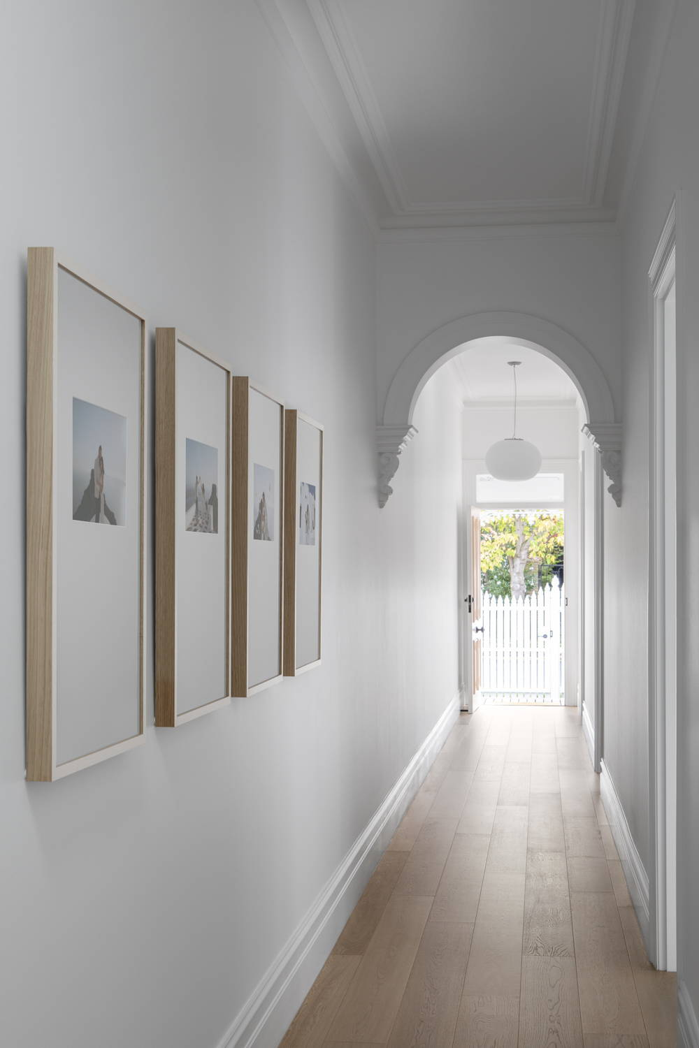 Gallery Wall of Framed Photography in a beautiful hallway