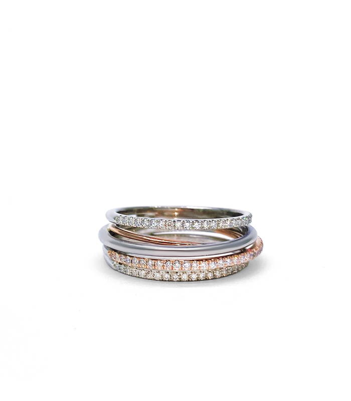Multiple interlocking rings in pink and white gold paved with small diamonds.