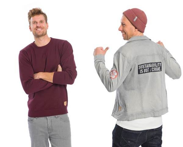 Man wearing burgundy organic cotton sweatshirt and man wearing grey organic cotton denim jacket with patches on, both from sustainable menswear brand Bleed Clothing