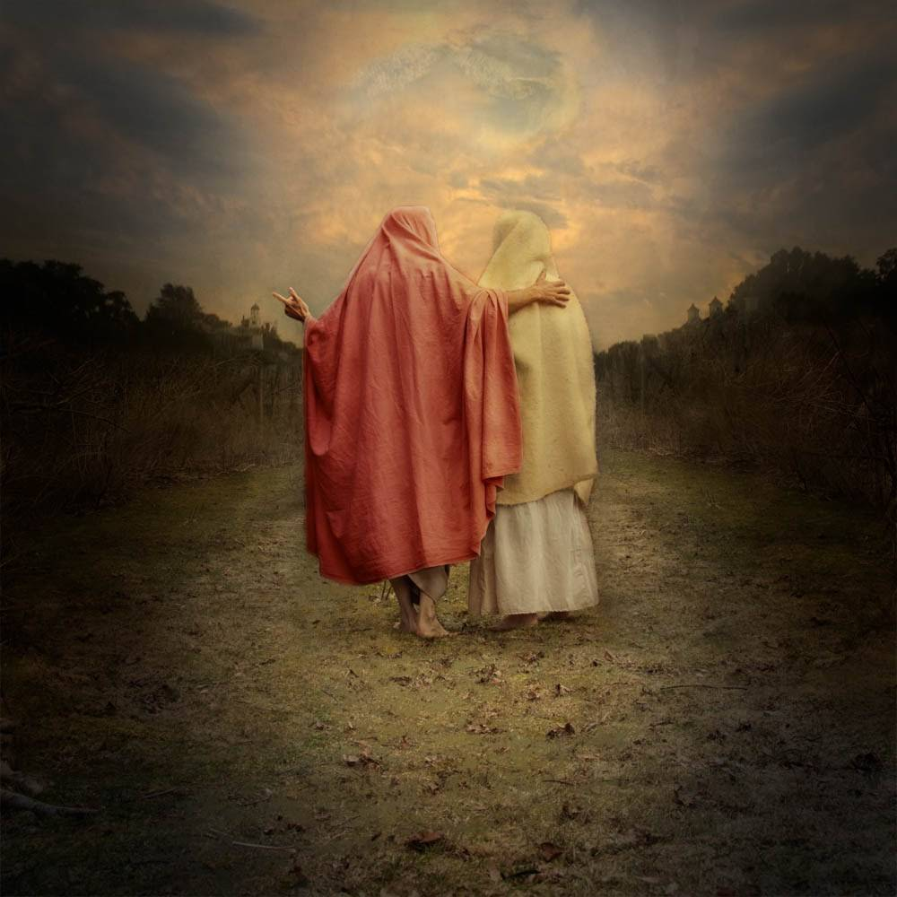 Two of Christ's apostles walking down a dirt path.