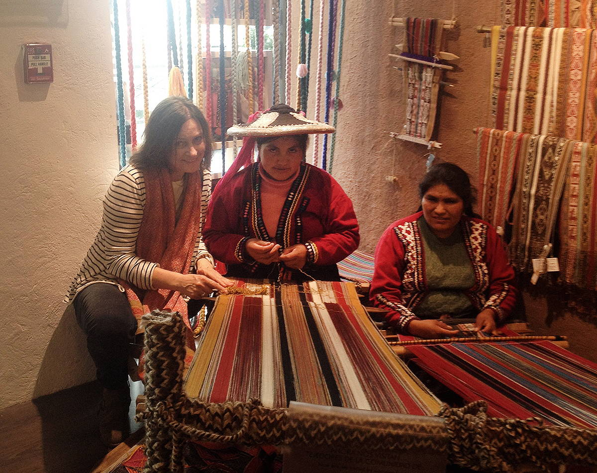 Margaret O'Leary collaborating with textile artisans on traditional looms in in Peru