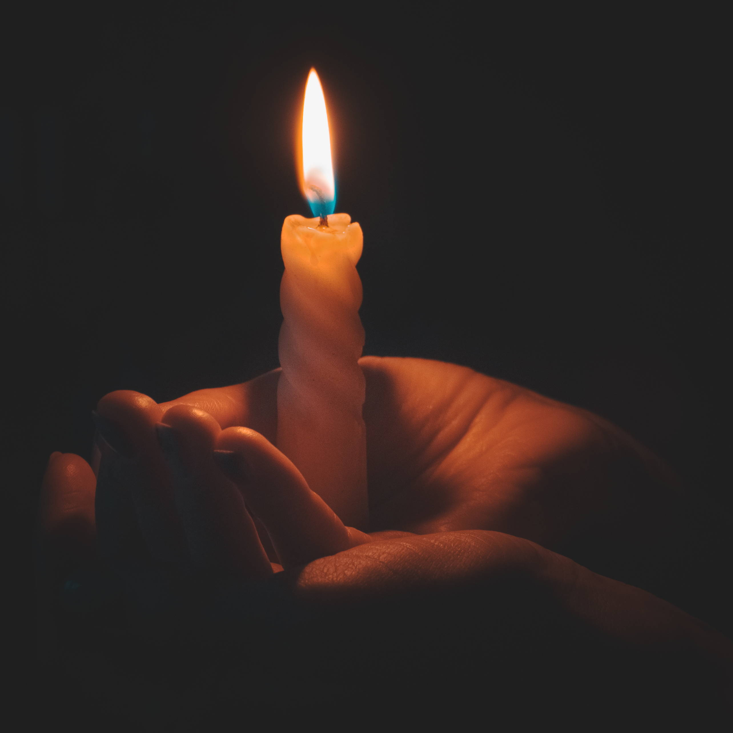 Male hands holding candle