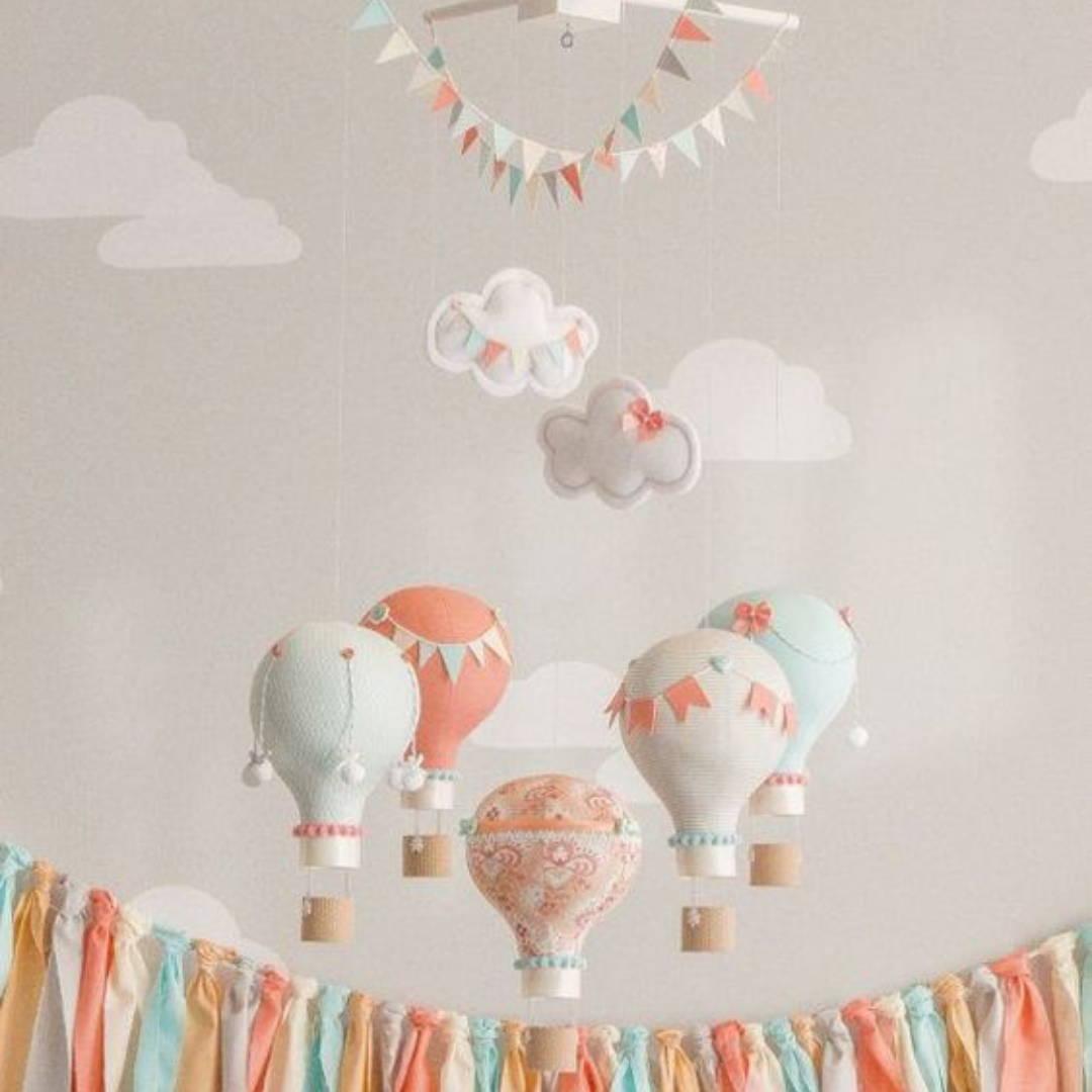 Colourful parachute themed overhead crib mobile