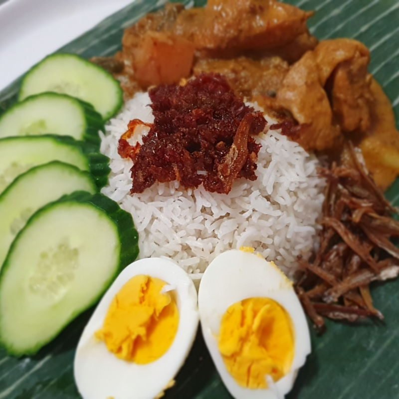 Tried the nasi lemak recipe with malaysian chicken curry and sambal. My boyfriend loved it!