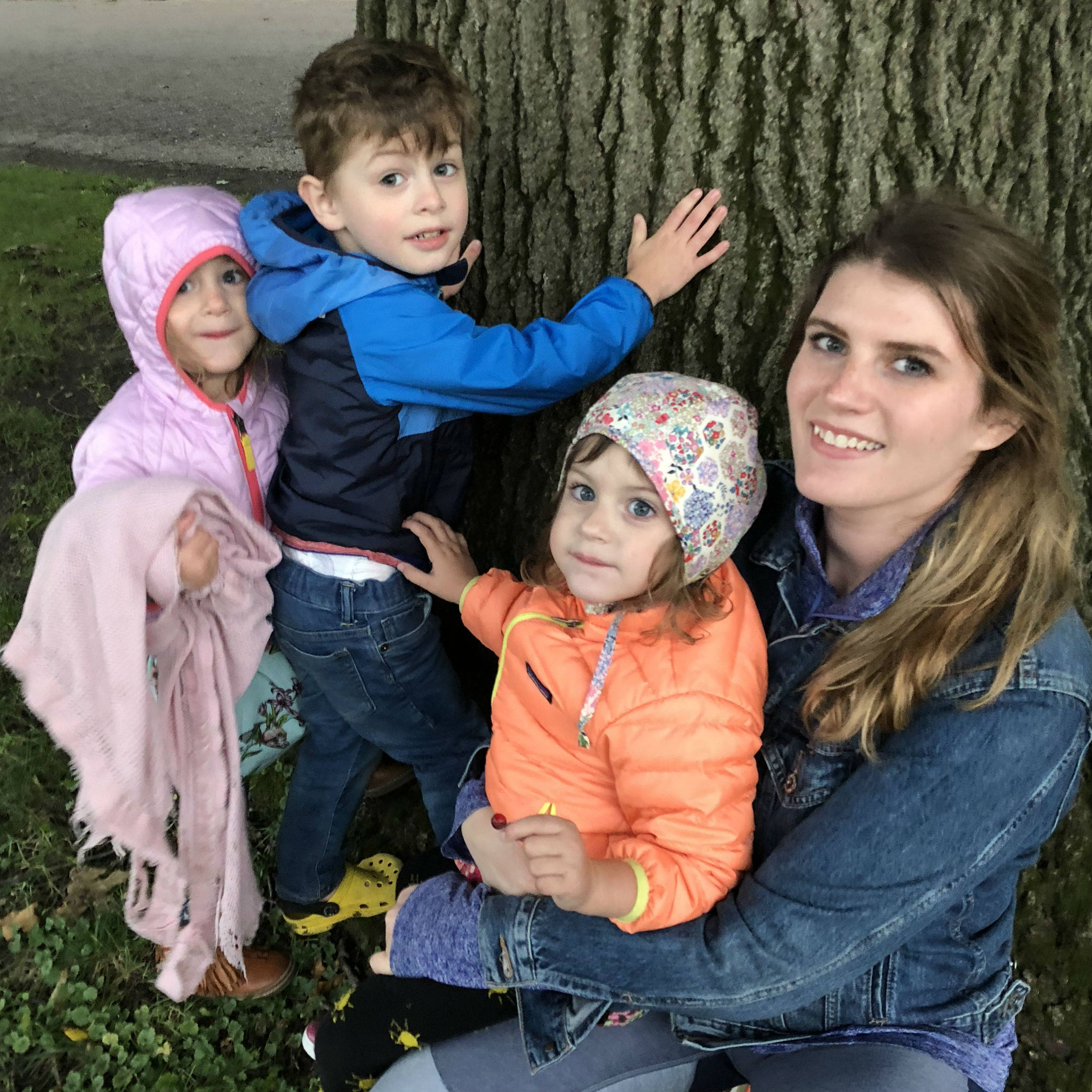 A photo of our December 2018 Still Kickin Hero, Rachel, and her three children.