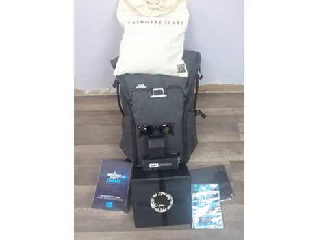 VIP Gift Backpack by AMC with Ray Ban Sunglasses, Wireless Headphones, Portable Image Projector, and More!