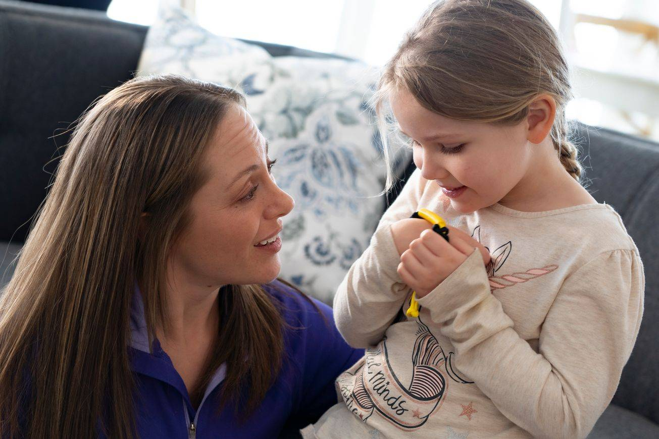 B-buddy hand-held chew oral tool being used with child and therapist