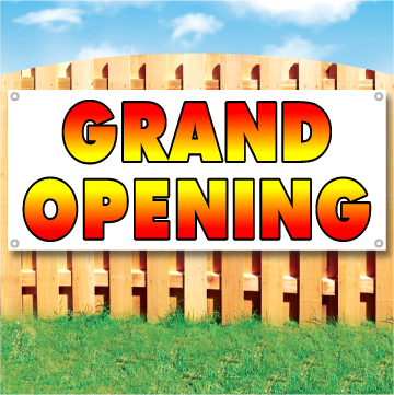 Wood fence displaying a banner saying 'GRAND OPENING' in red and yellow text on a white background