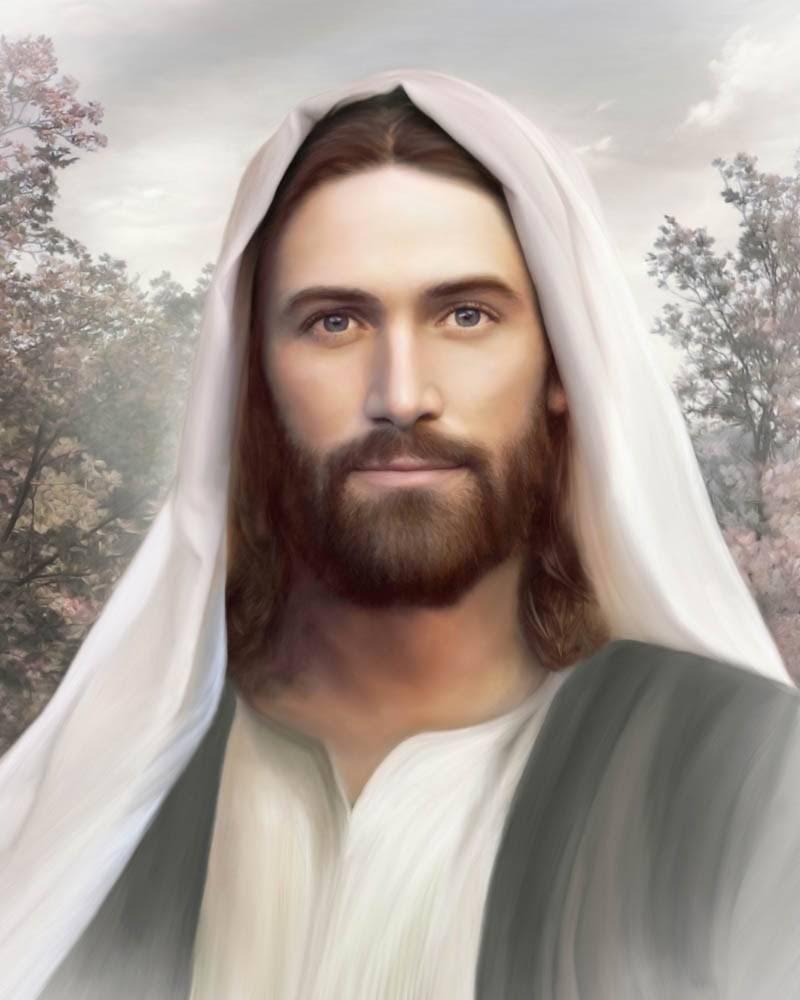 Peaceful portrait of Jesus framed in white light.