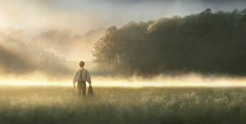 Joseph Smith crossing a field toward a grove of trees.