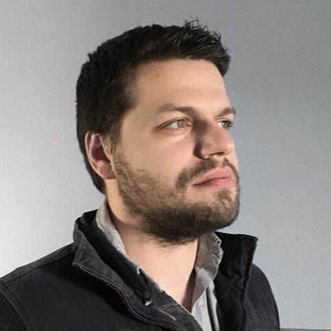 Bearded gentleman - Chris Van Wiemeersch`s headshot next to his testimonial on Uploadcare cloud uploader