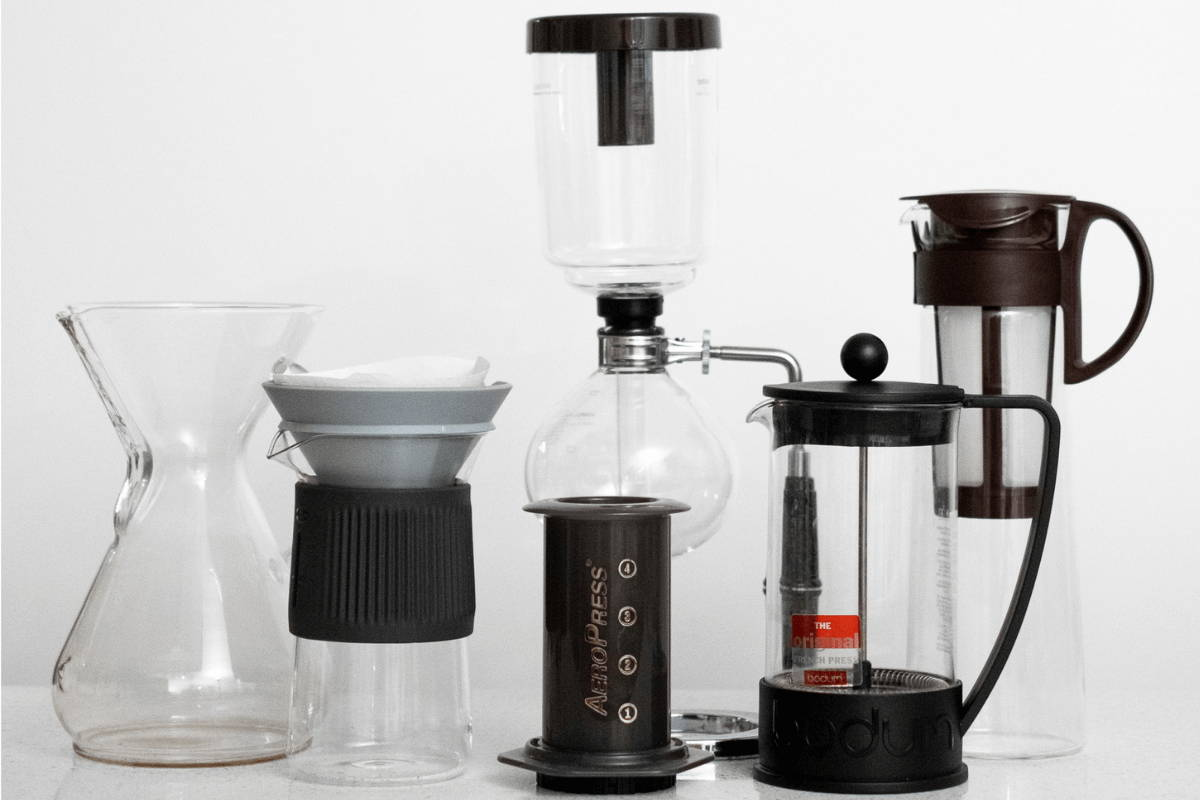 At-home brewing instruments, including an Aeropress, several pour over machines, and a French press.
