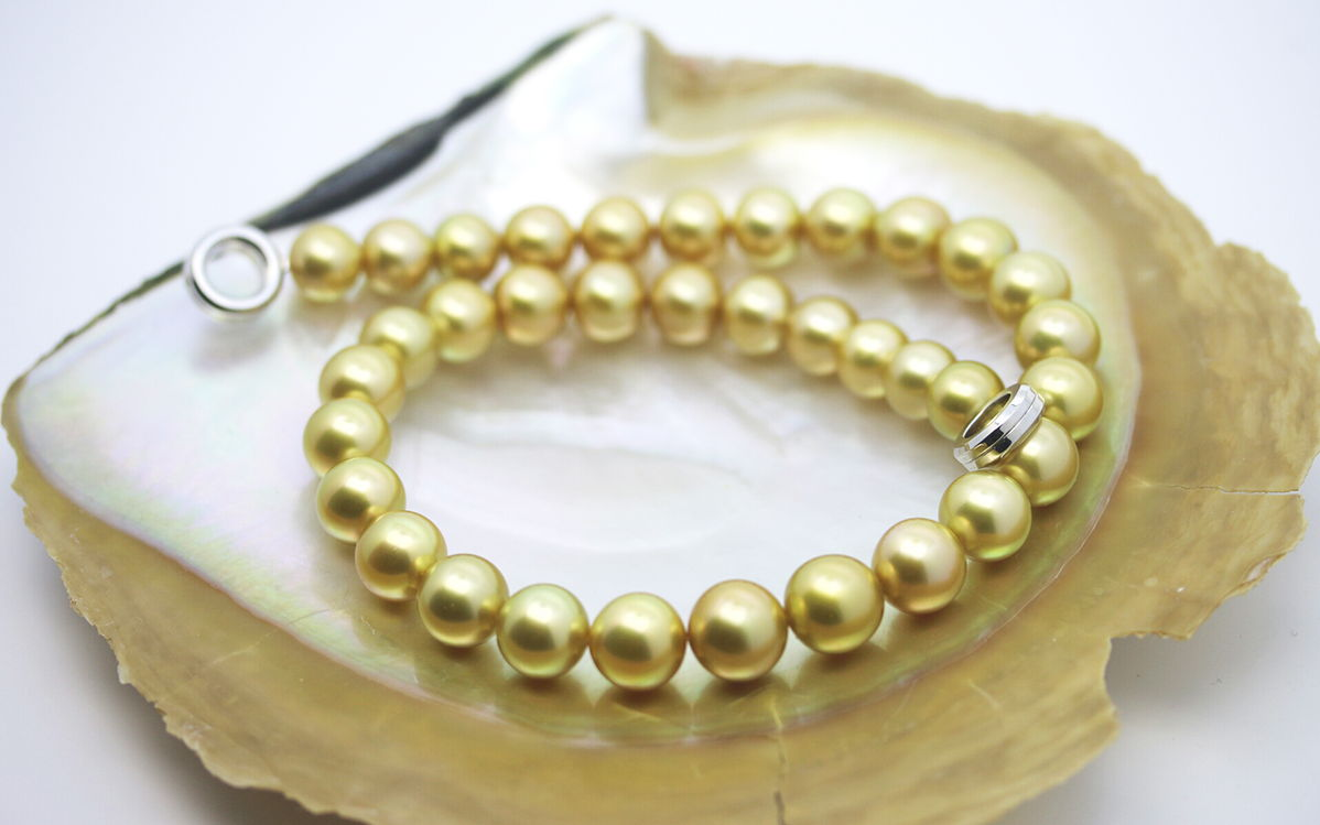 South Sea Gold Pearl Strand in an Oyster Shell