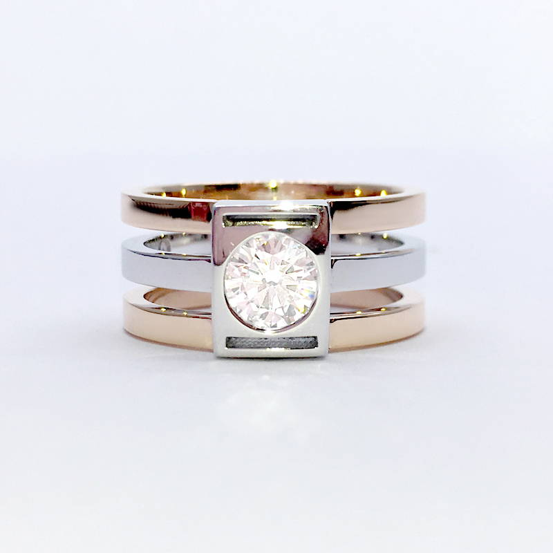 two-tone ring with three separate rings set with a large diamond