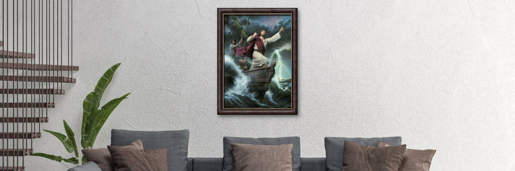 Environment shot of a living room wall displaying a framed painting of Jesus calming the seas.