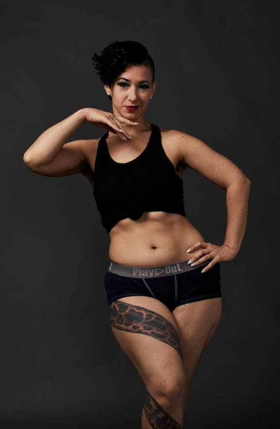 Female model wears navy low rise boxer briefs underwear and black unisex tank top