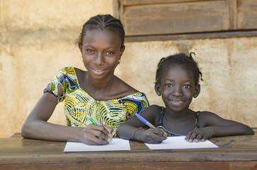 african girls learning at a desk