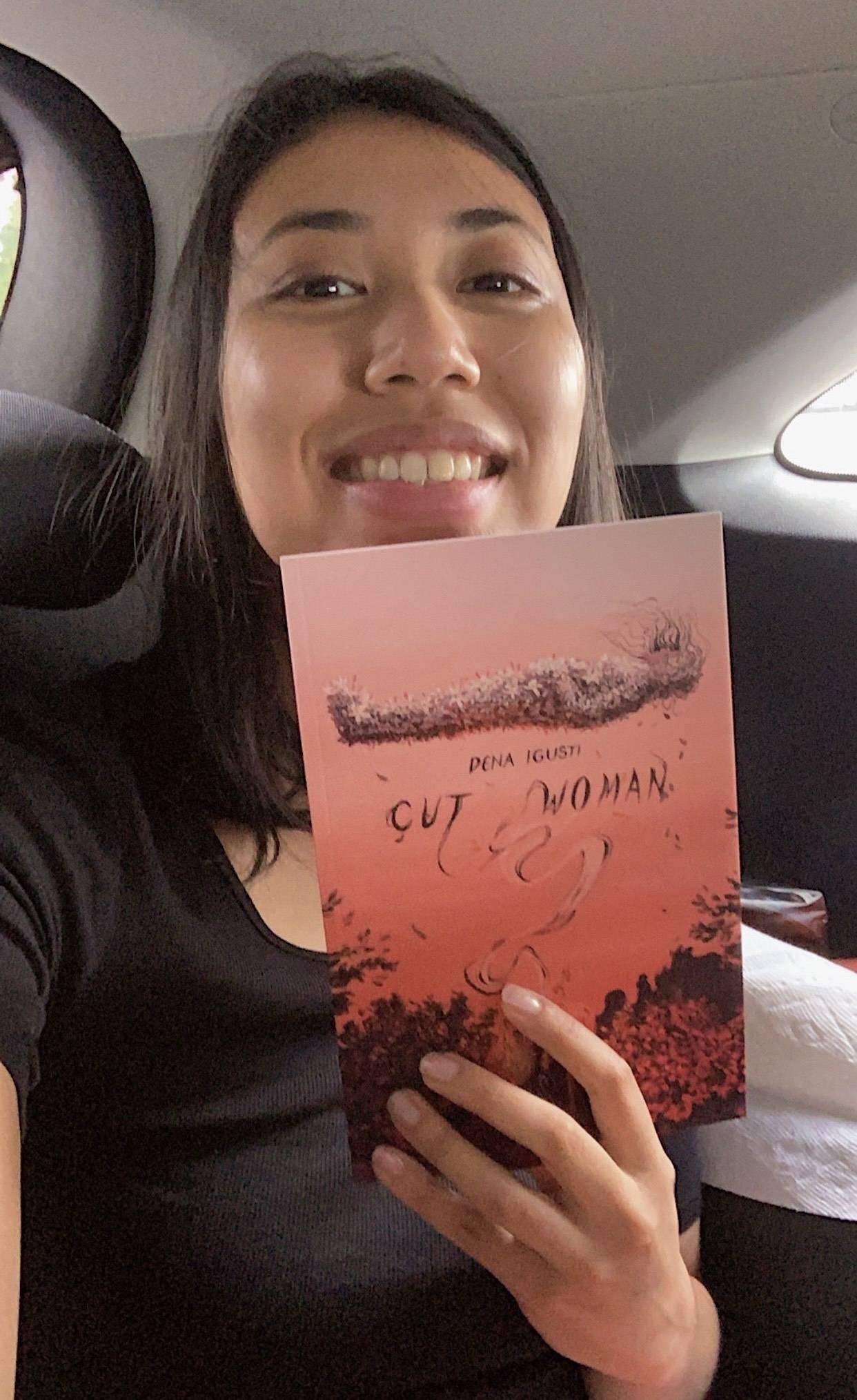 Dena Igusti with her book entitled Cut Woman