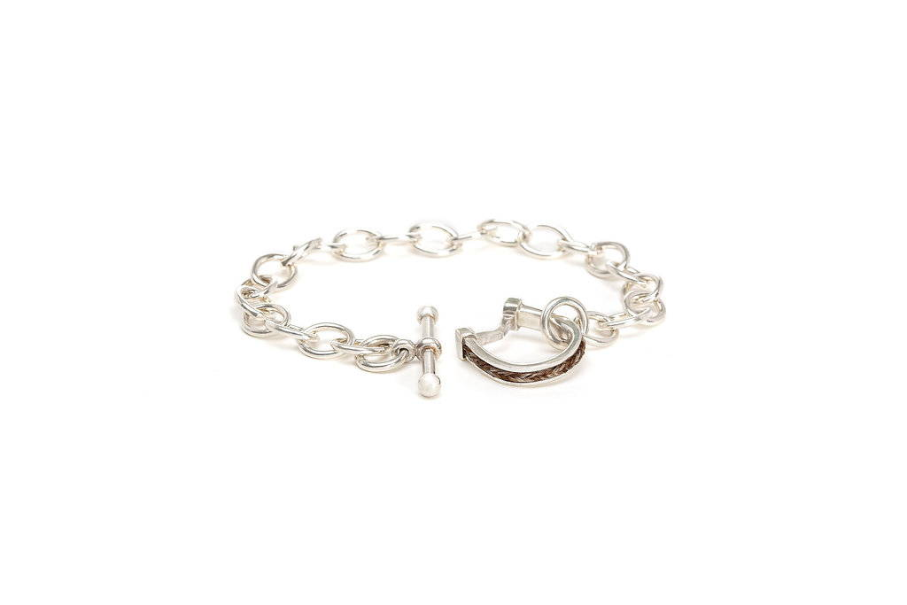 Sterling silver horseshoe toggle bracelet with inset horsehair braid