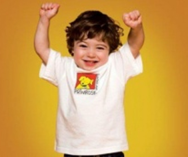 Young Primrose toddler cheers with his arms up in the air