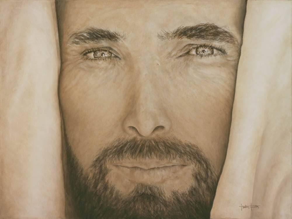 Up close portrait of Jesus. He has a gentle smile.