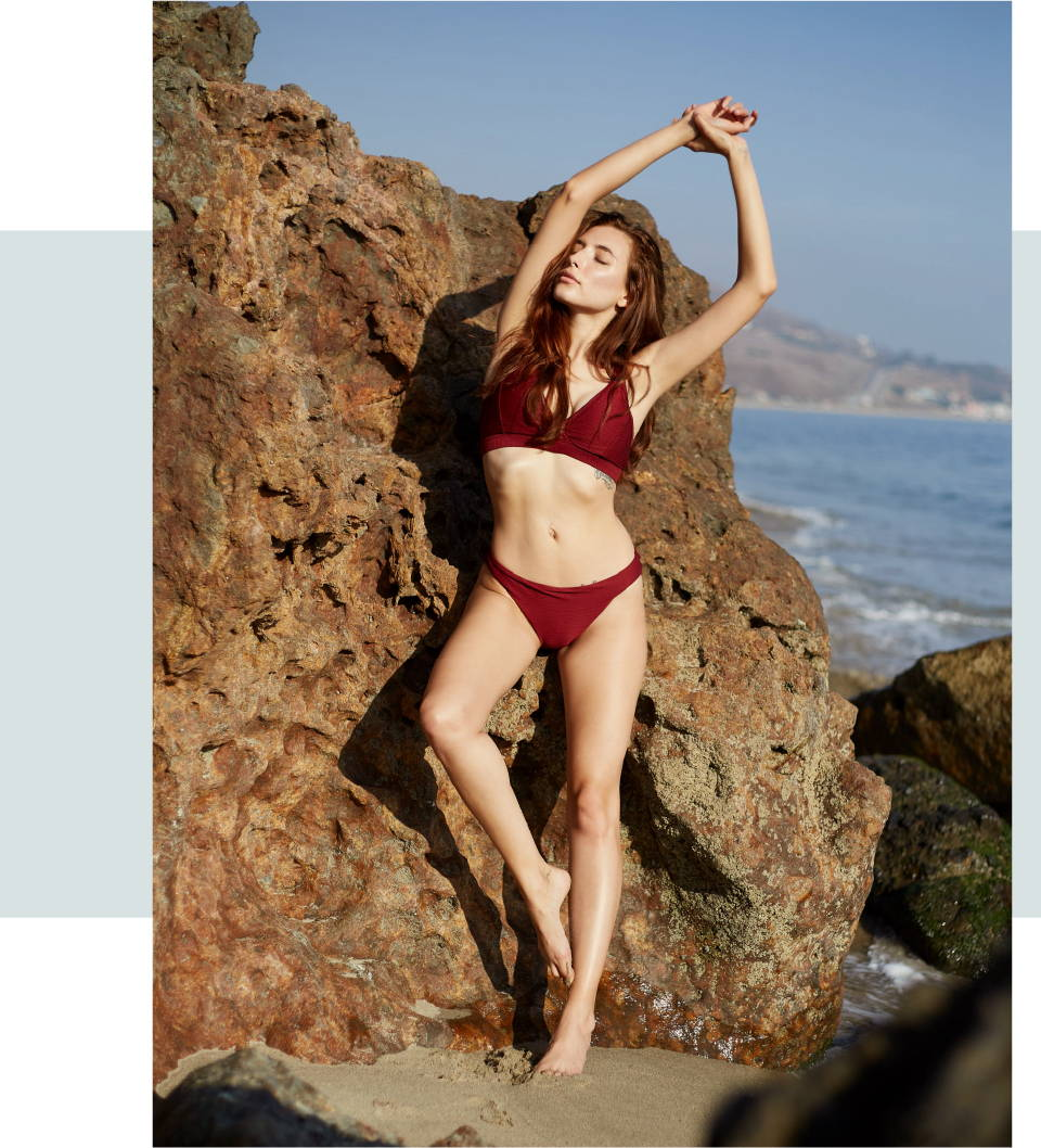 Aly Rae is wearing SKYE's Seraphina top and the Angelina bottom in the Romance Red color from the GEMS collection.