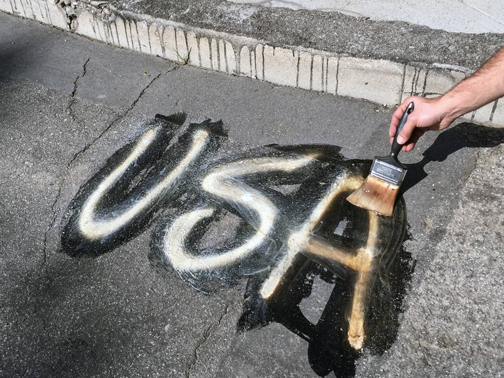 removing paint from asphalt