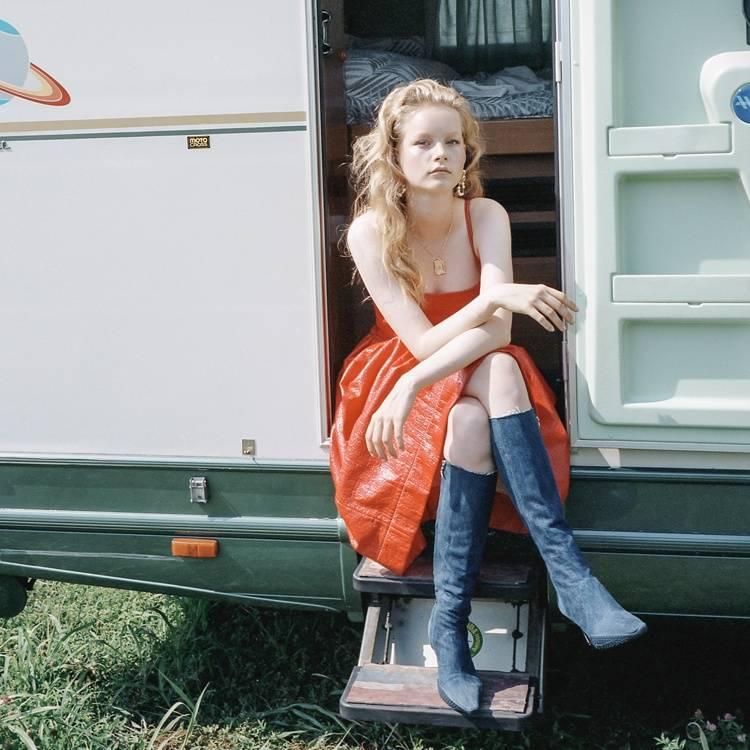 a woman is sitting in a caravan