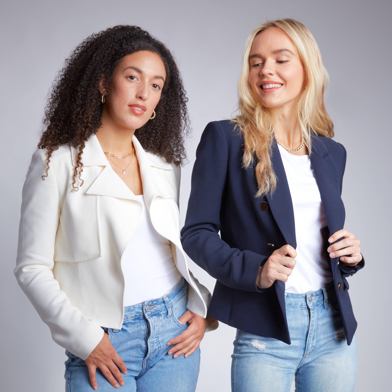 IXORA Apparel two models; one brunette model wearing white jacket and blonde model wearing navy blazer