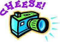 """A green and blue cartoon camera flashes under the word """"cheese"""""""