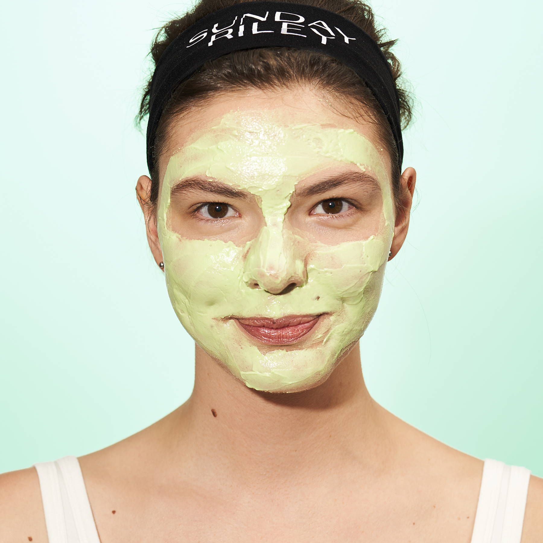 A woman wearing the Green Martian face mask.