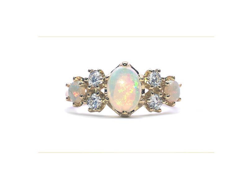 royal ring with 3 opals and 4 diamonds