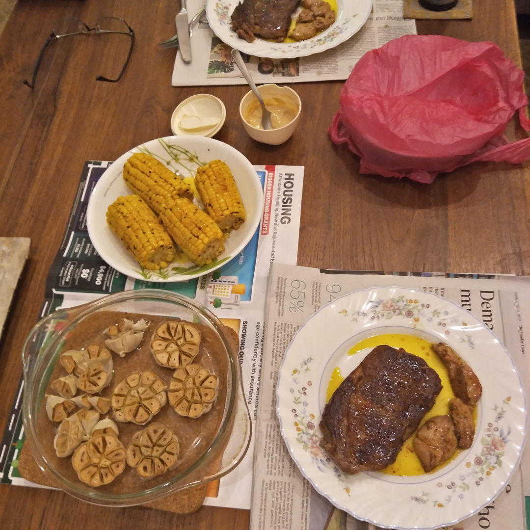 medium rare ribeye, foie gras, roasted garlic and buttered corn on the cob with homemade mustard - super yummy!