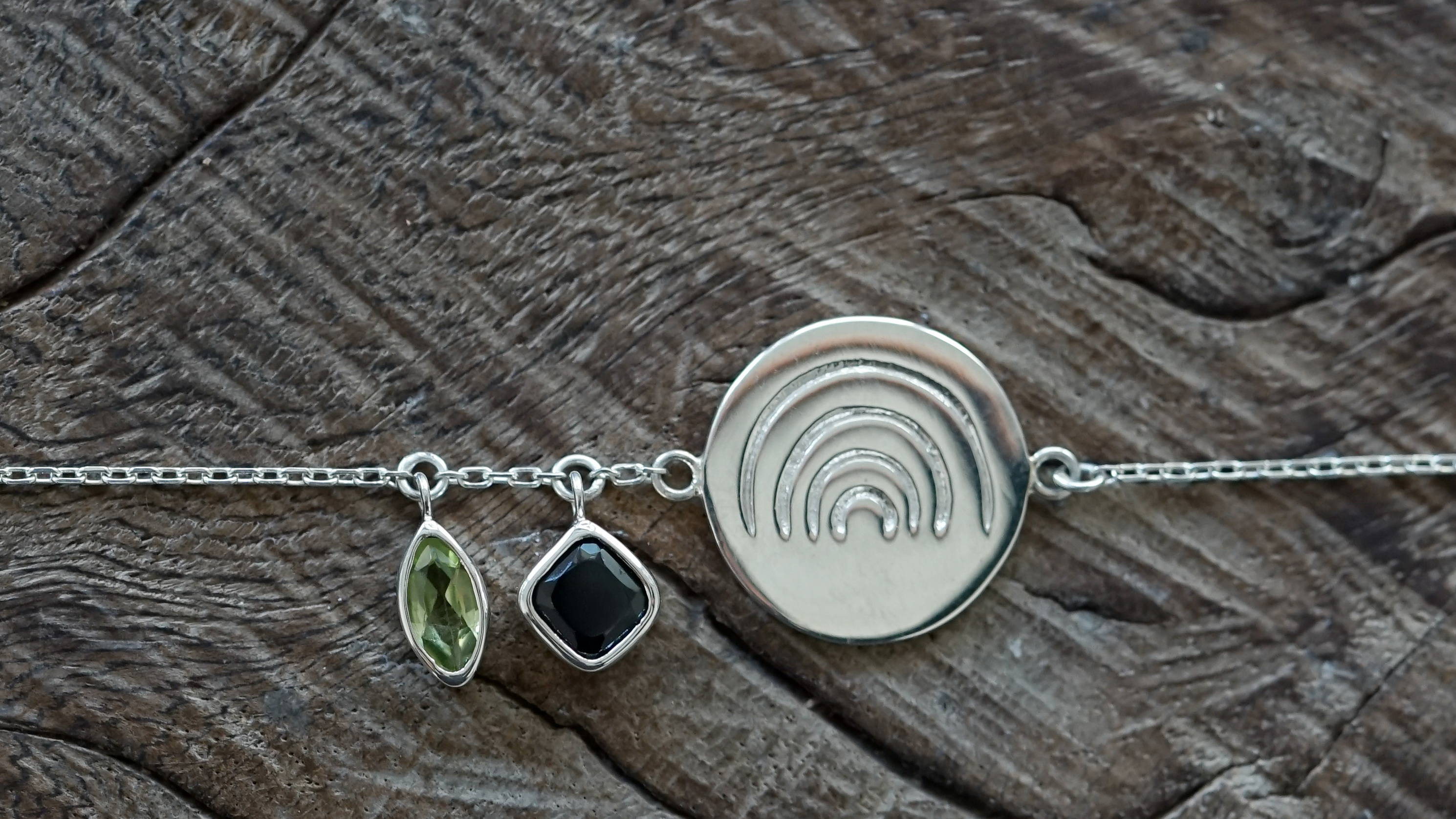 Customized silver bracelet with gemstones