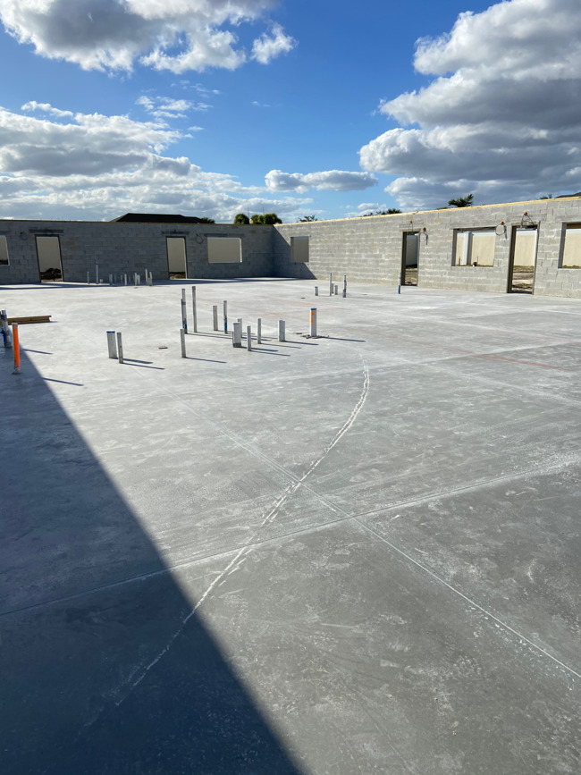 picture of concrete slab with plumbing pipes