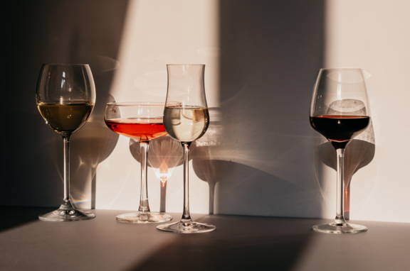 A variation of four different wine glasses; red, rosé, white, sparkling wine glasses dipslaying the importance of shape and size.