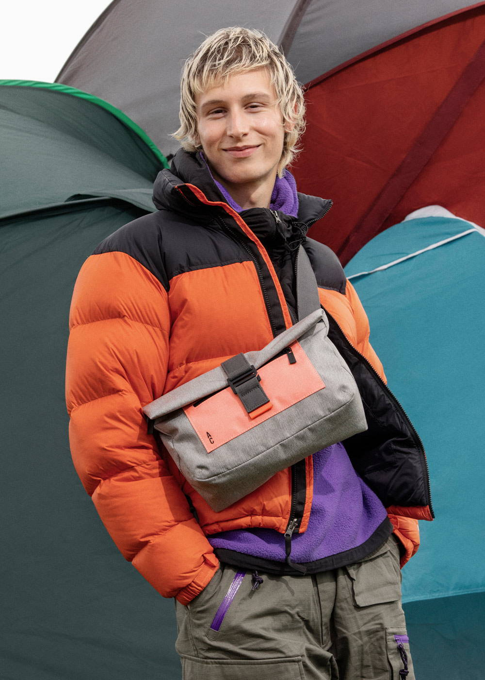 Model wearing the Travis Travel and Cycle Satchel in Grey/Orange
