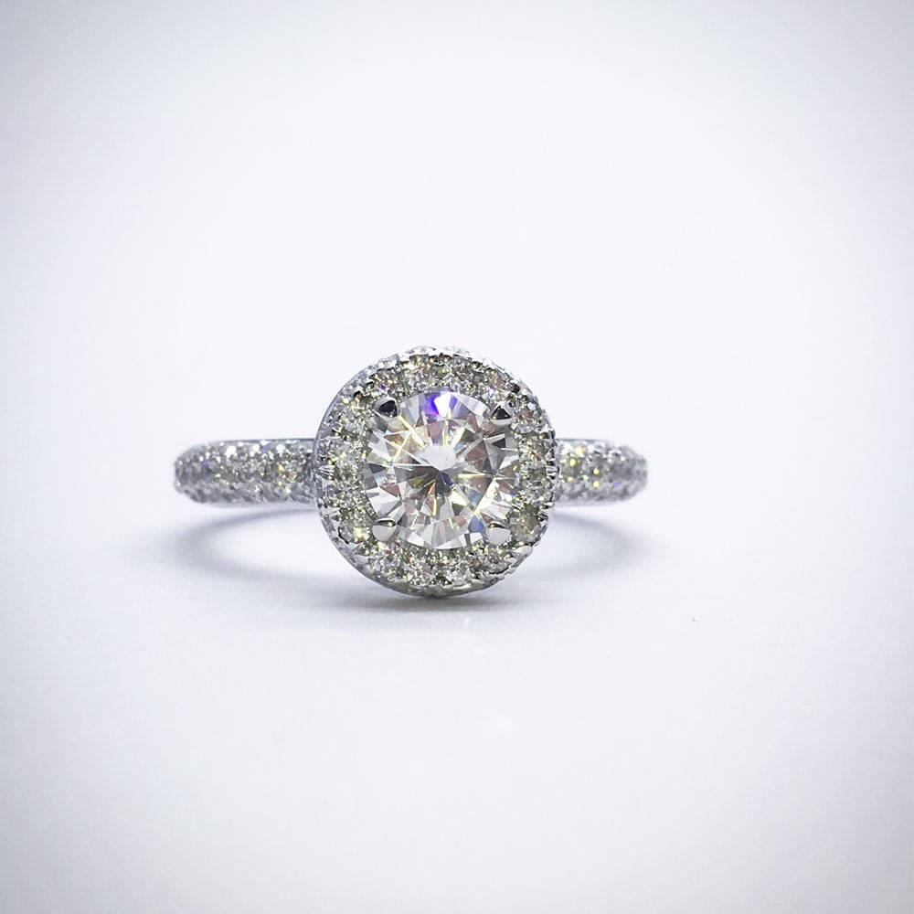 Engagement ring in moissanites with round diamond in halo