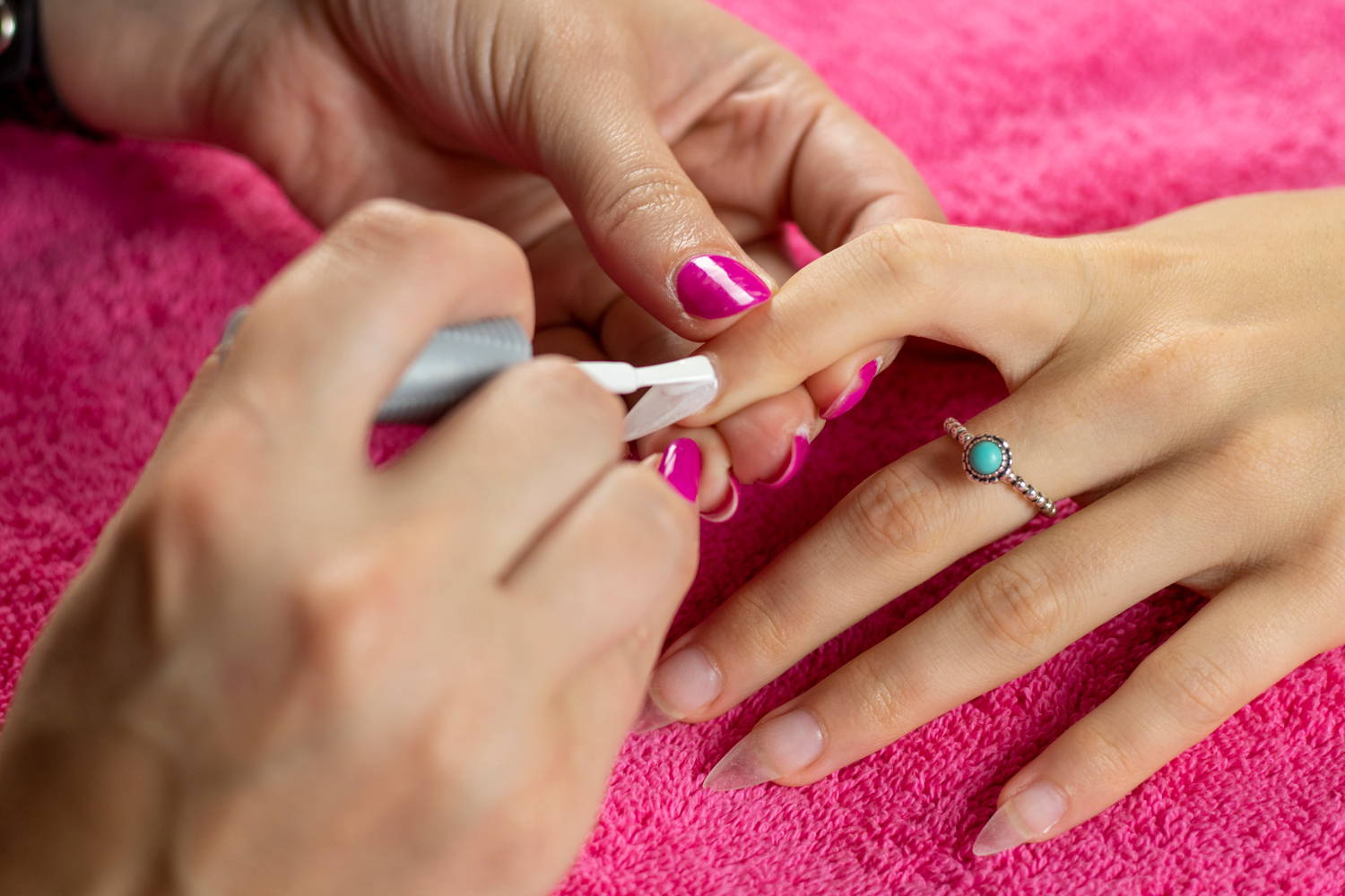 Nail being painted with ORLY GelFX White Tips