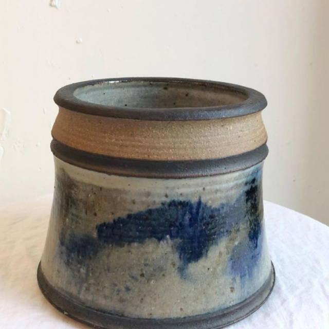 Vintage ceramic pot with blue accents