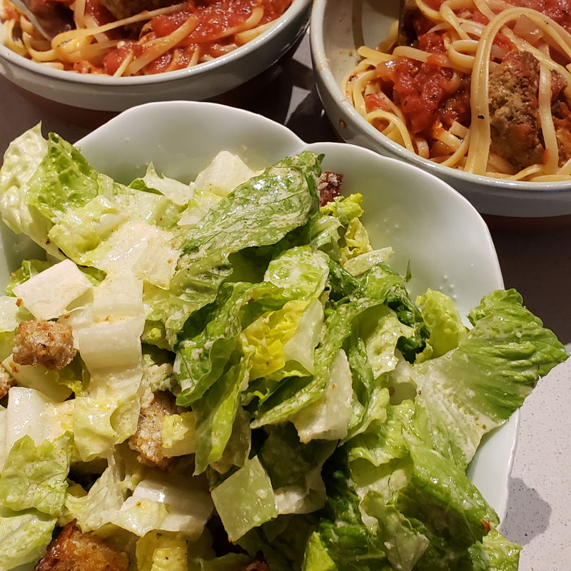 Spaghetti and meatballs With caesar salad and homemade croutons