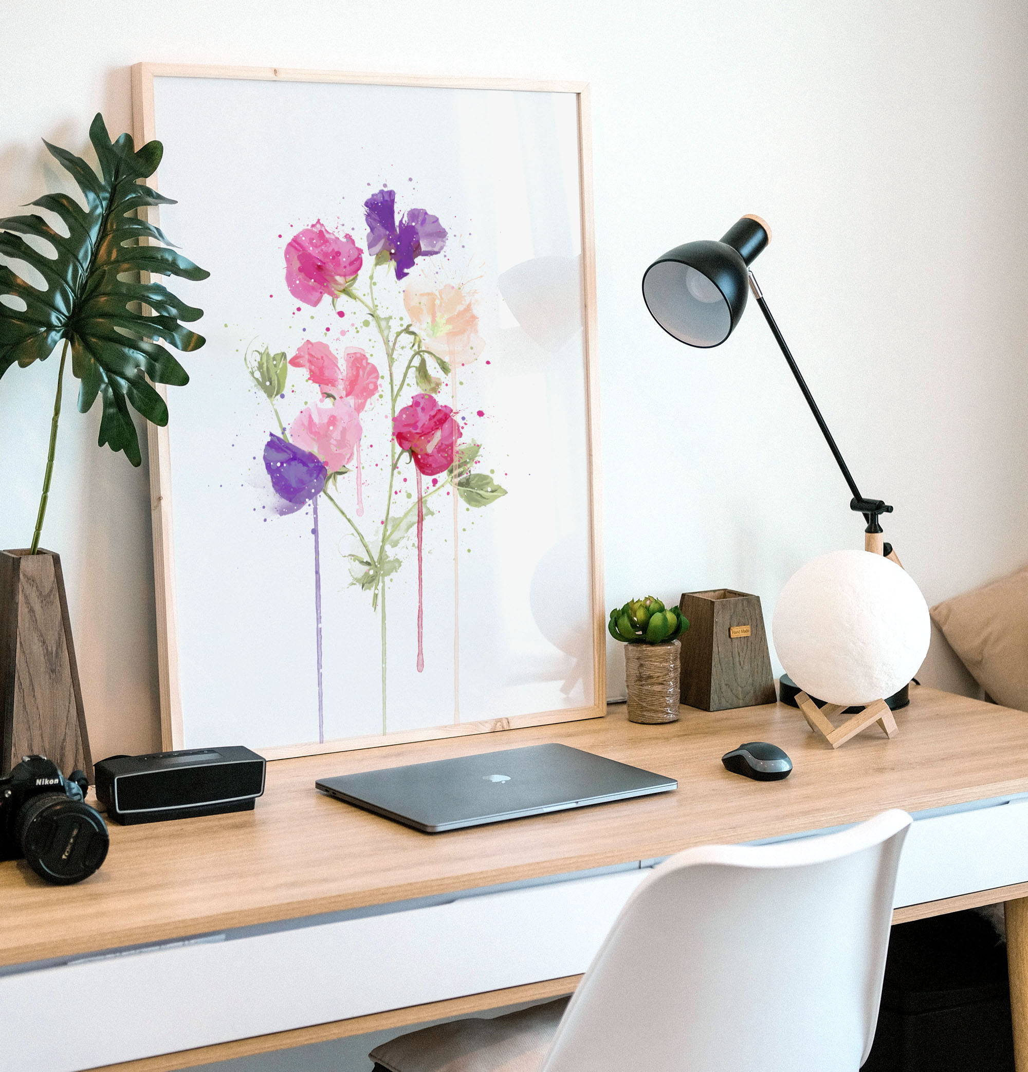 Home office desk setup with Sweet Pea wall art print