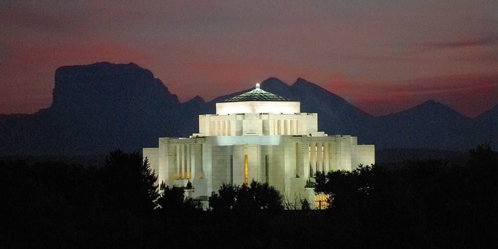 Panoramic Cardston Alberta Temple against an evening sky.